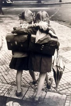 2 girls with book satchels